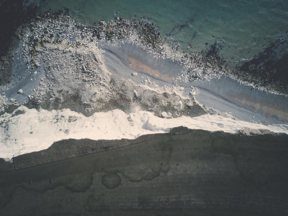 sea ocean water beach aerial view sand rocks