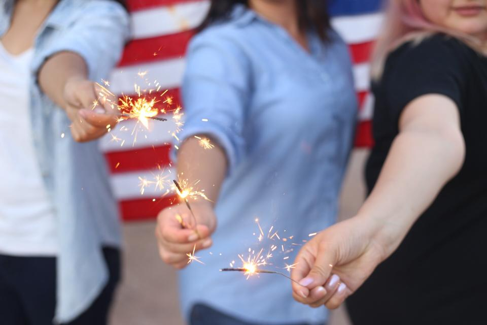 sparklers people hands celebration american flag party friends group