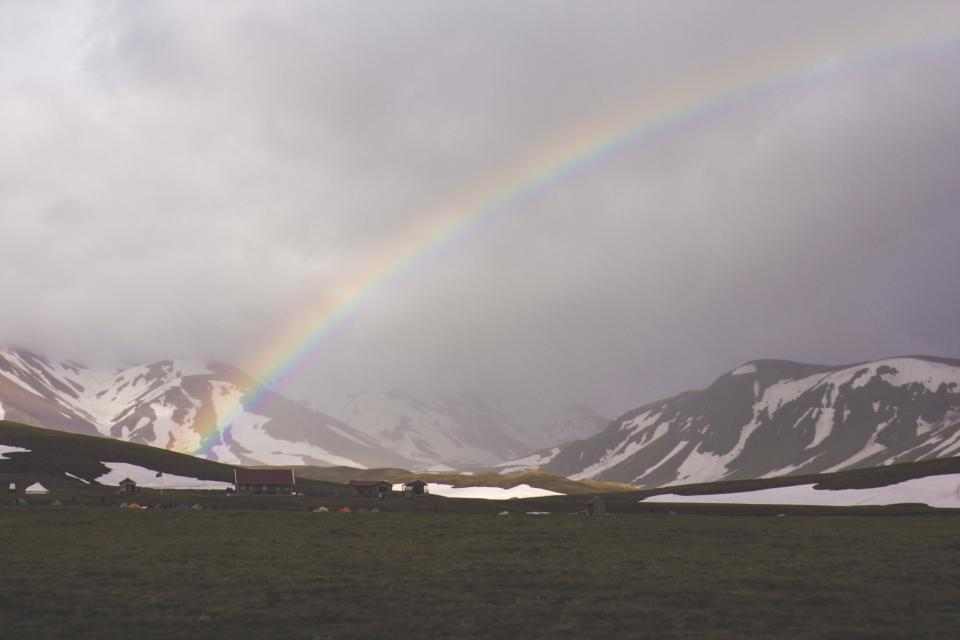 rainbow sky clouds cloudy fog mountains peaks snow grass field valleys nature landscape