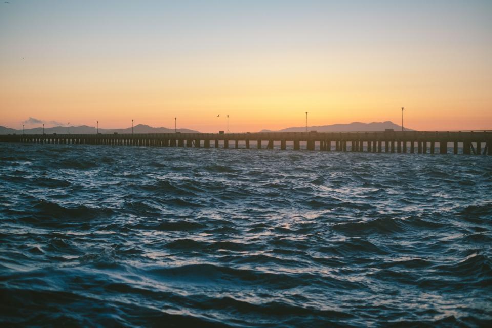 sea ocean water waves nature sunset bridge view
