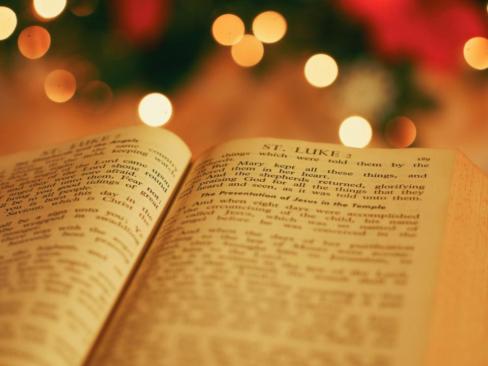holy book bible reading religious bokeh blur christmas light