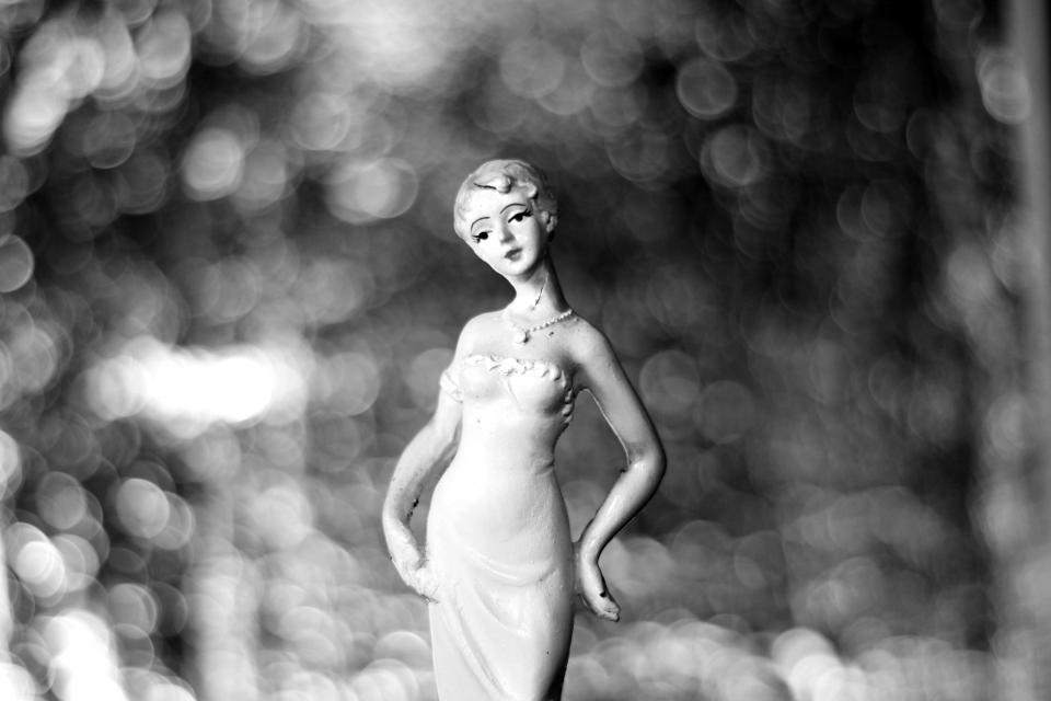 black and white woman figurine bokeh