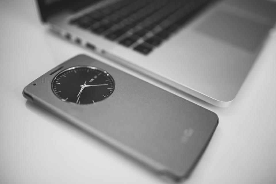 macbook laptop computer smartphone mobile technology business clock black and white
