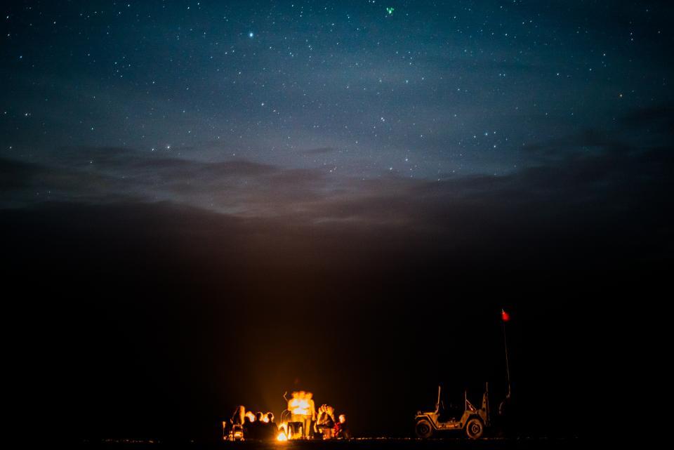 dark, night, campfire, picnic, flame, light, car, flag, people, women, men, sky, stars