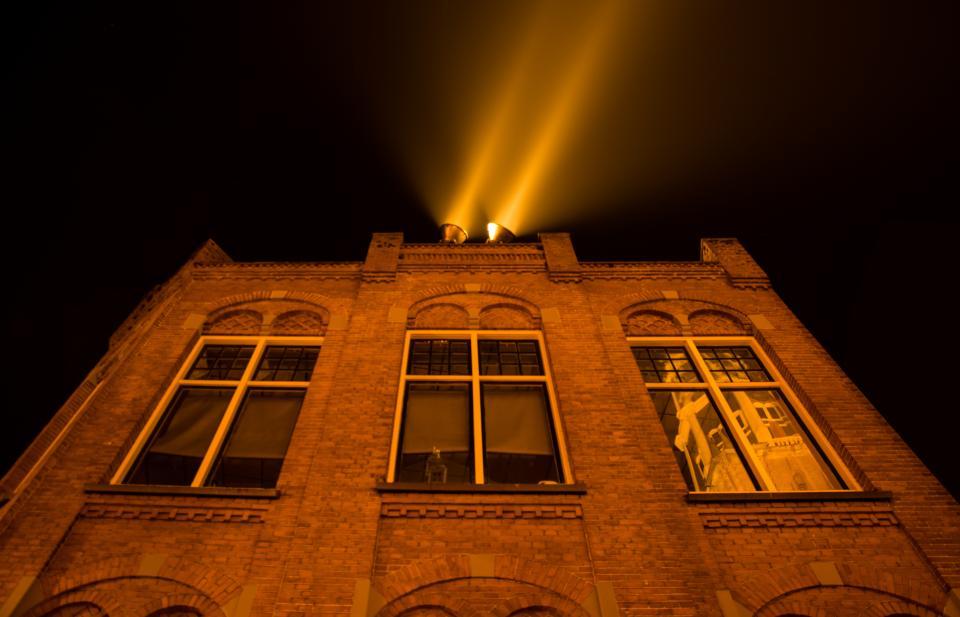 building architecture wall bricks spotlight windows dark night sky