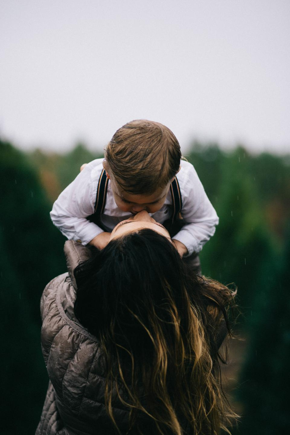 people mother son woman kid child baby boy kiss love blur nature outdoor