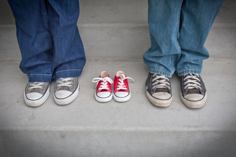 people body anatomy limbs legs feet sneakers shoes couple baby jeans concrete stairs steps family