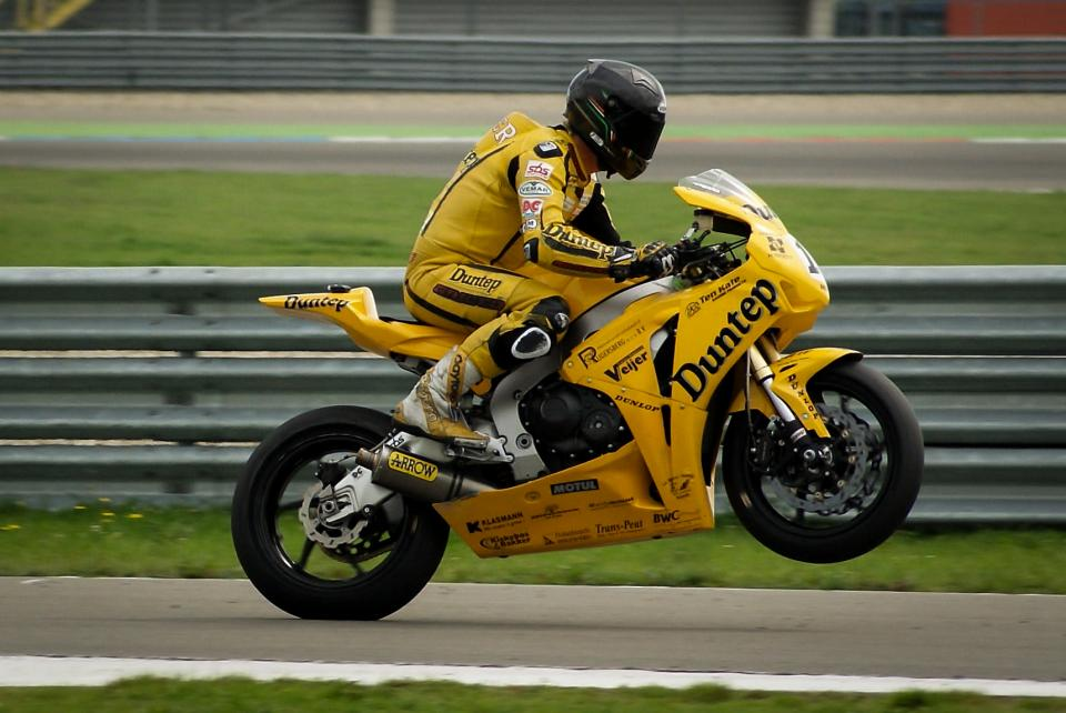 motorcycle, bike, racing, racer, helmet, wheelie, race track, guard rail