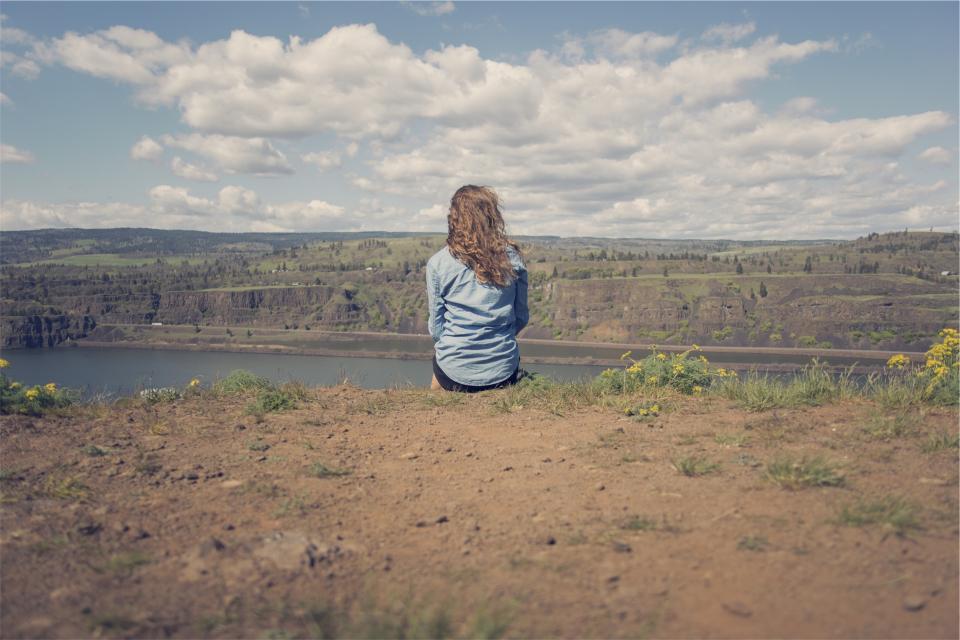 girl woman brunette long hair curls denim shirt dirt landscape nature mountains hills fields lake water clouds blue sky