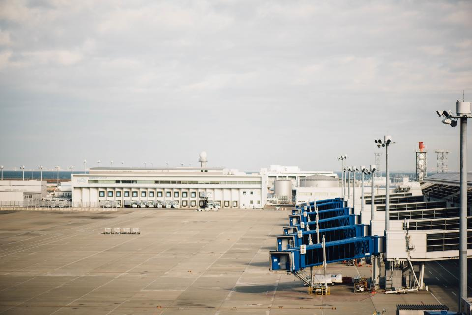 airport, airplane, runway, travel, transport, hanger, baggage, wings, truck, loader, spot light, post, tower, ambulance, tank