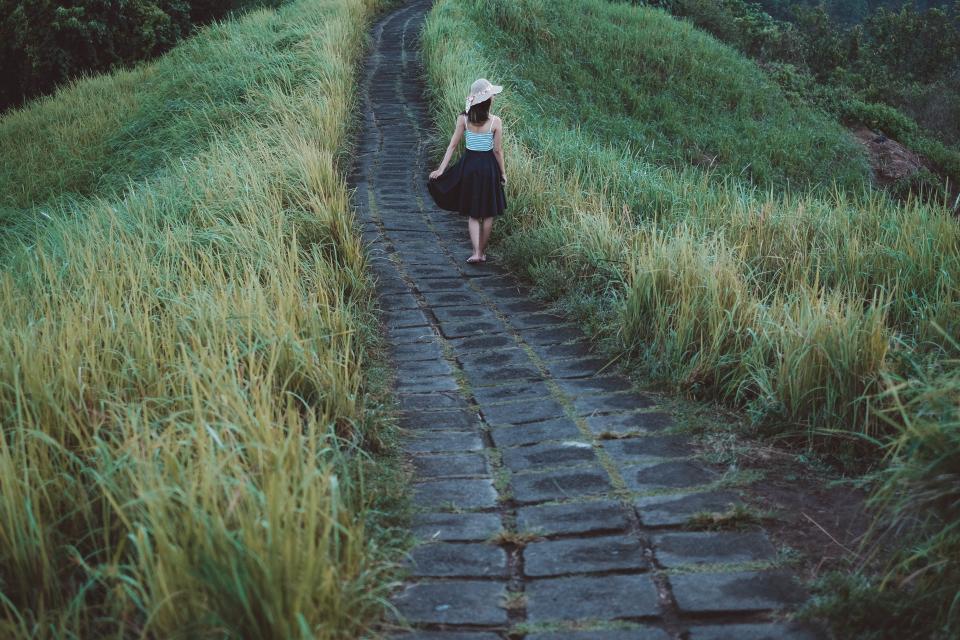 people girl walking path green grass landscape highland nature