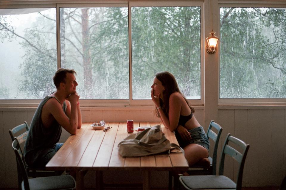 people man woman date love intimate lunch windows woods forest green rain chairs table food restaurant
