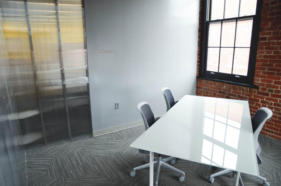 startup office table chairs business meeting