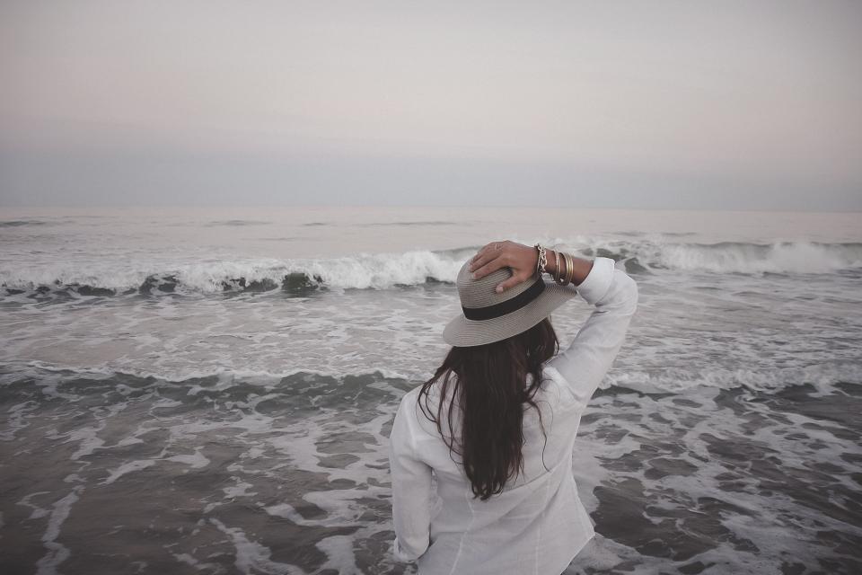 girl woman hat brunette long hair beach sand shore waves ocean sea horizon people horizon looking fashion model