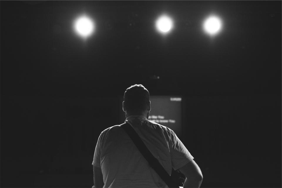 musician music instrument guitar strap man guy people concert spotlights show entertainment