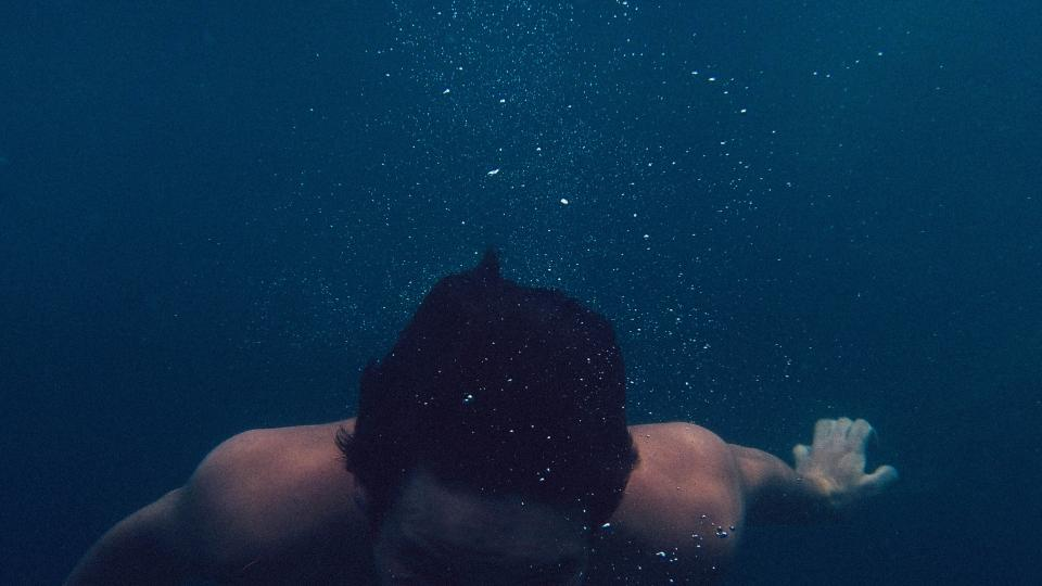 swimming underwater man guy hair bubbles wet