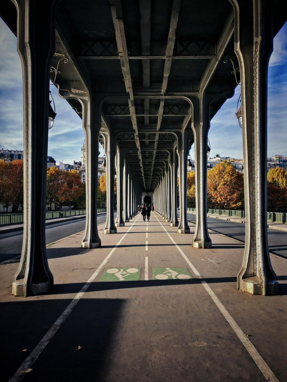 bridge urban city people couple happy walking architecture infrastructure structure trees autumn fall building