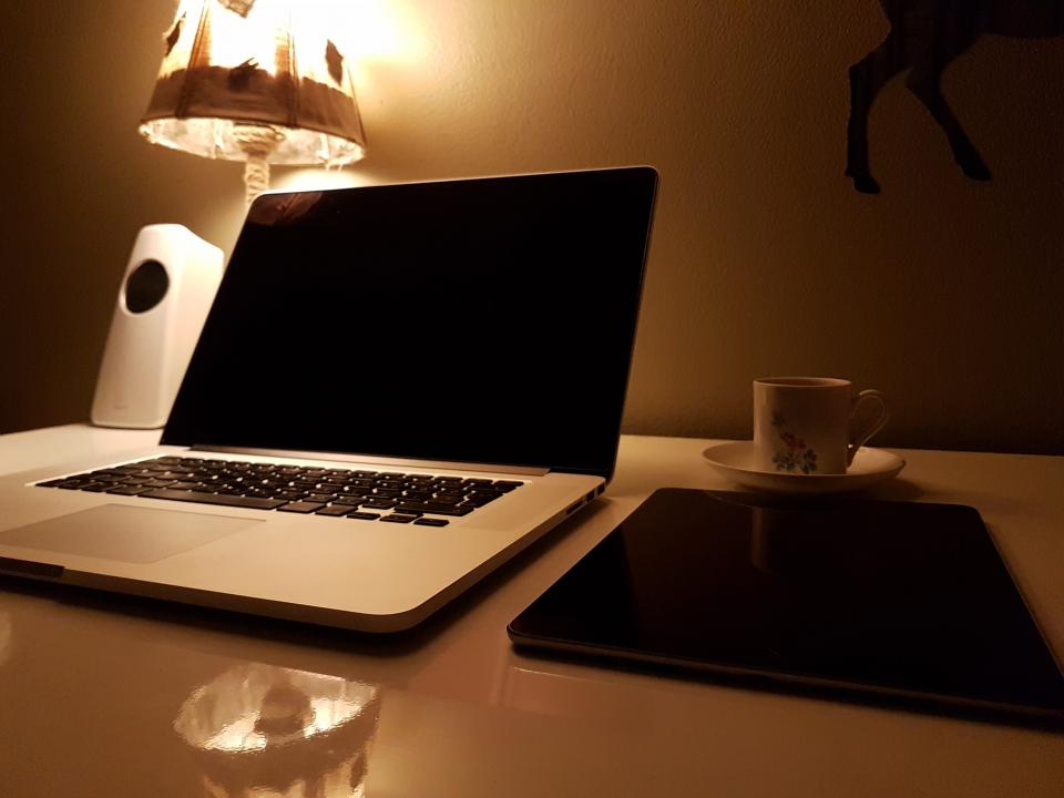 laptop, computer, gadget, modern, technology, electronics, research, work, business, coffee, drink, cup, saucer, table, desk, office, wall, lampshade, reflection, light