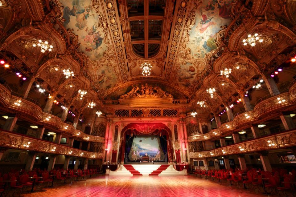 architecture, building, structure, ceiling, chandelier, lights, sculpture, art, design, chairs, stage