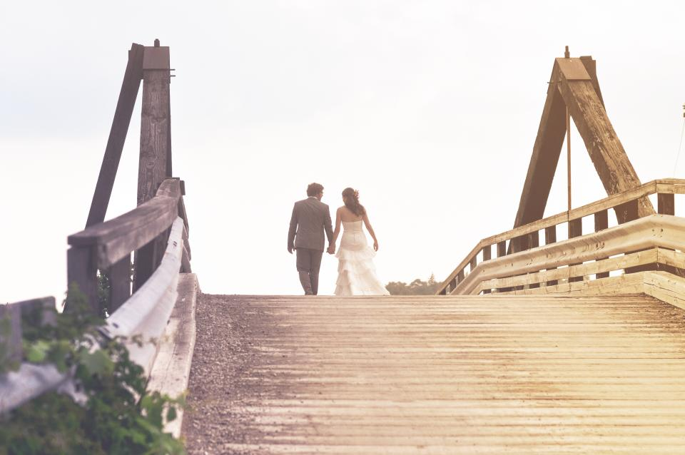 people man woman bride groom wedding couple love holding hands walking bridge