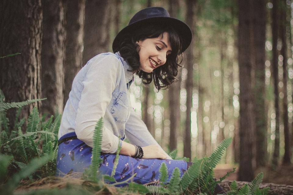 people girl woman smile happy beauty fashion clothing hat cap bracelet green plant ferns forest trees bokeh
