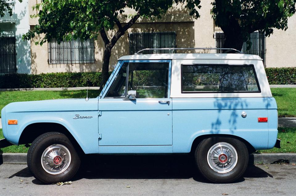 bronco, truck, suv, baby blue, wheels, tires, vintage, old, street, grass, sunny
