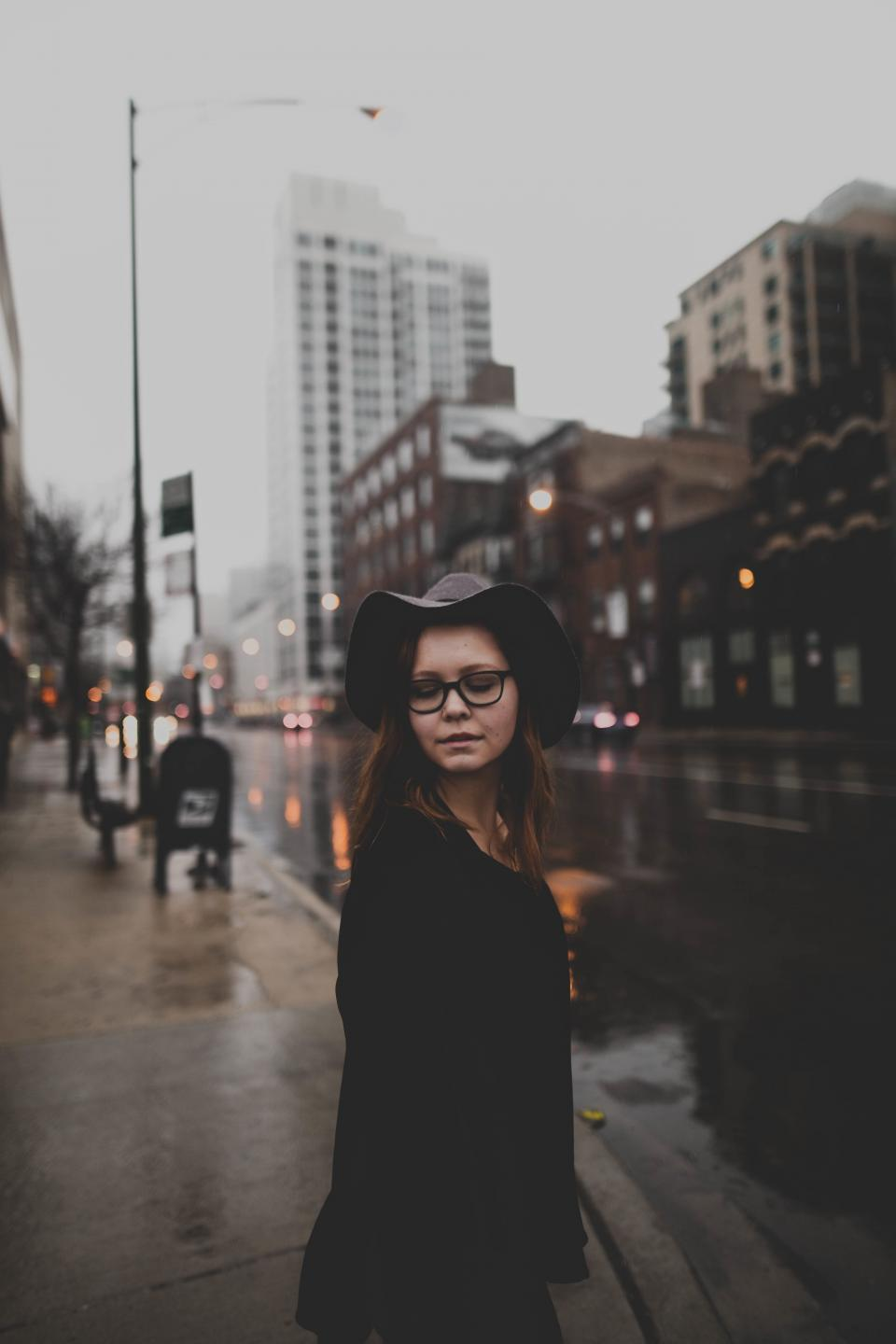 people, woman, urban, city, street, rain, wet, road, establishment, building, store, restaurant, shop, eyeglasses