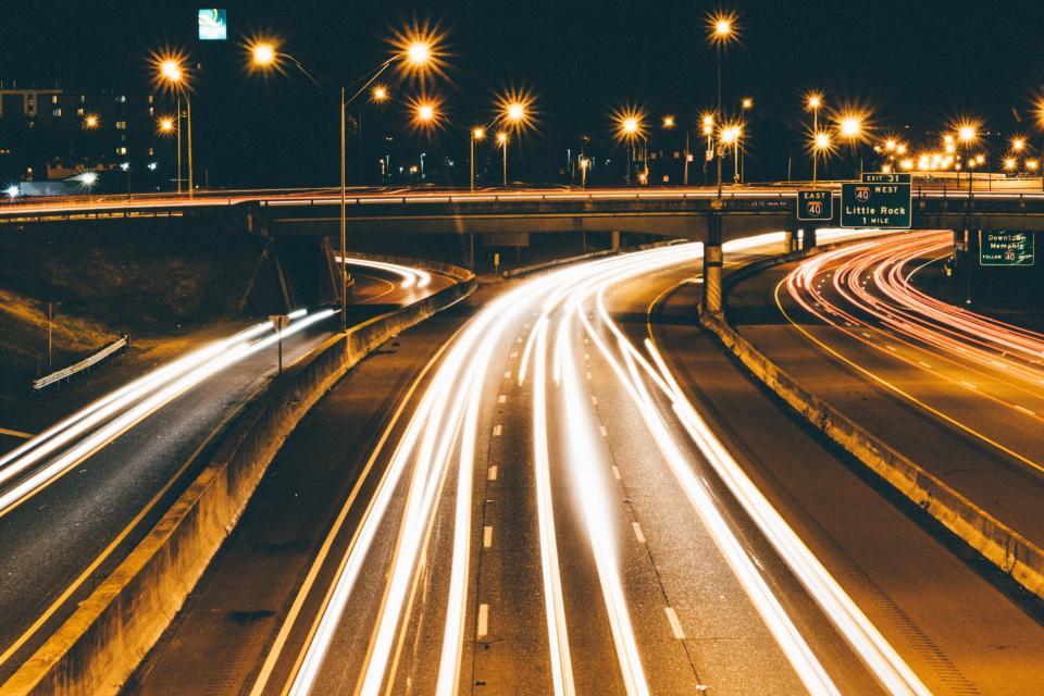 highway overpass roads lights dark night traffic lamp posts evening city urban driving