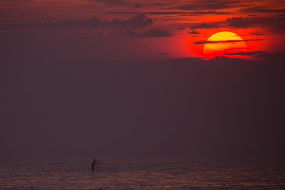 sea ocean water wave nature people silhouette dark sky cloud sunset