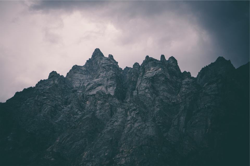 mountains cliffs rocks clouds cloudy dark sky