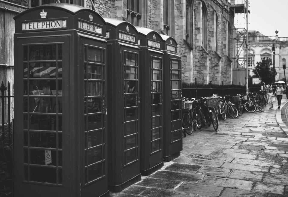 people, pedestrian, woman, kid, child, baby, mother, parent, black and white, monochrome, telephone, station, bicycle, street, building, establishment