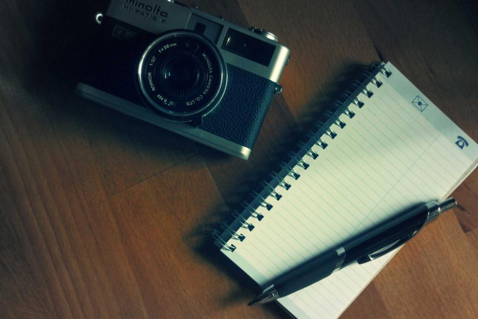 camera notepad pen photography office desk wood creative business slr objects