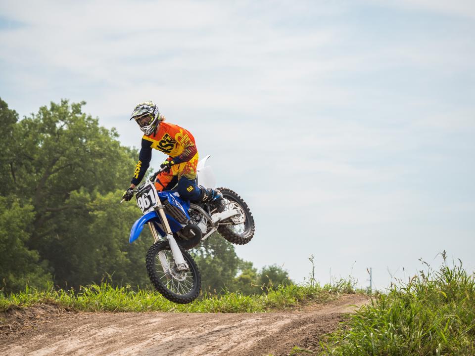 motorcycle, shot, wheels, helmet, path, grass, man, guy, sports, trees, green, clouds, sky, racing, racer, bike