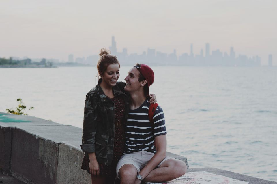 young girl guy people couple love romantic hat shorts tshirt jacket dress camouflage water skyline