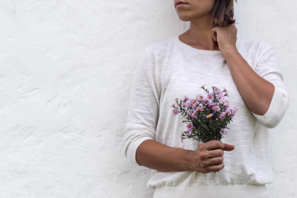 white wall people woman girl flower