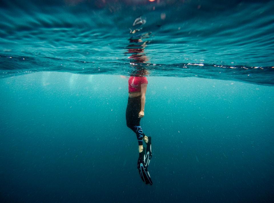 underwater ocean sea water woman girl swimming swim blue salty wet suit fins boots people