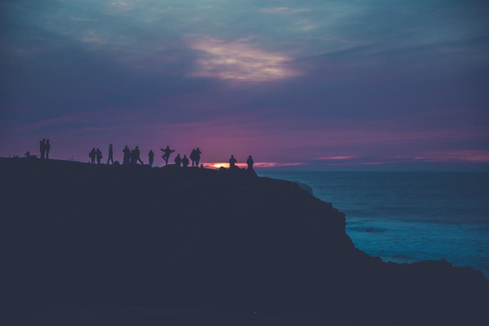 silhouette people sea night water ocean mountain mountaineer sky clouds men women adventure travel trip sunset landscape nature