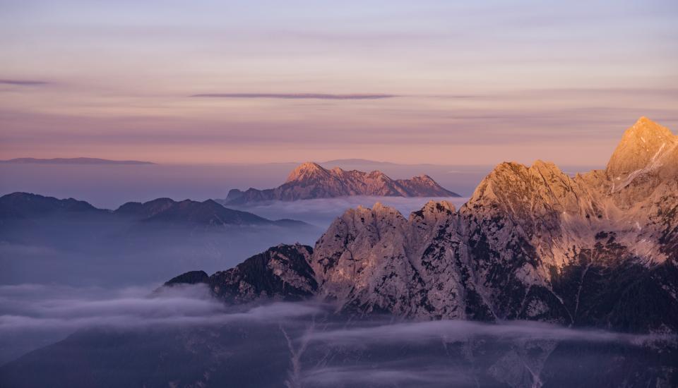 mountains peaks summit landscape nature cliffs clouds sky foggy adventure