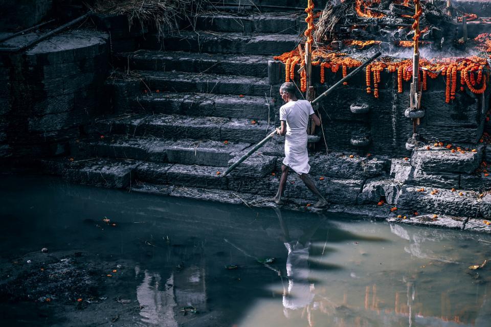 people man walking outdoor water reflection rocks stair