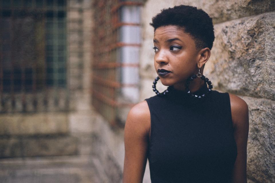 people woman earrings fashion lipstick house blur black african american