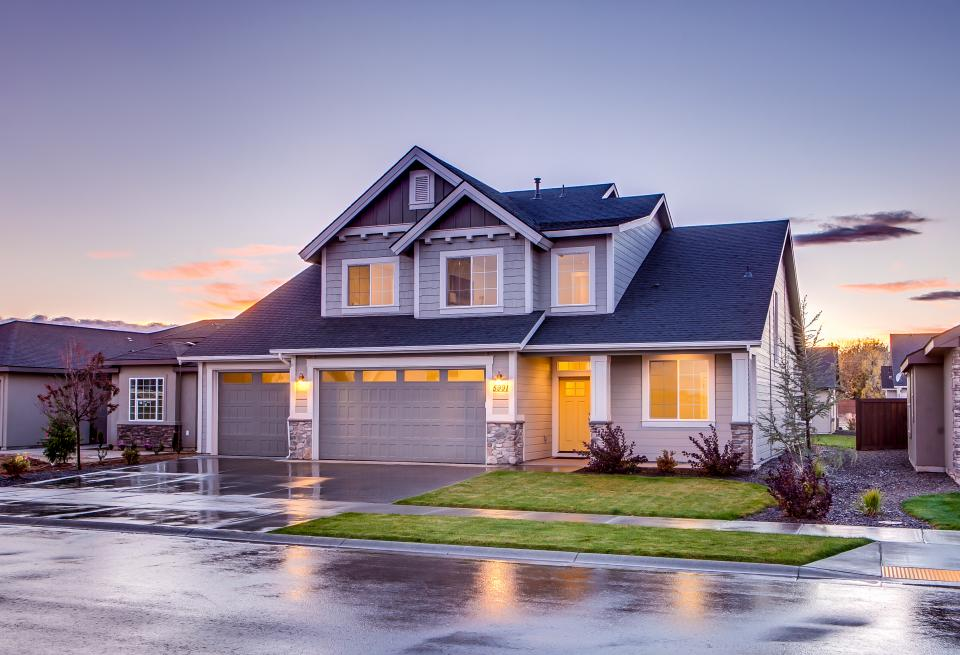 architecture house home residence exterior lawn driveway garage yard windows neighborhood suburbs landscape view road