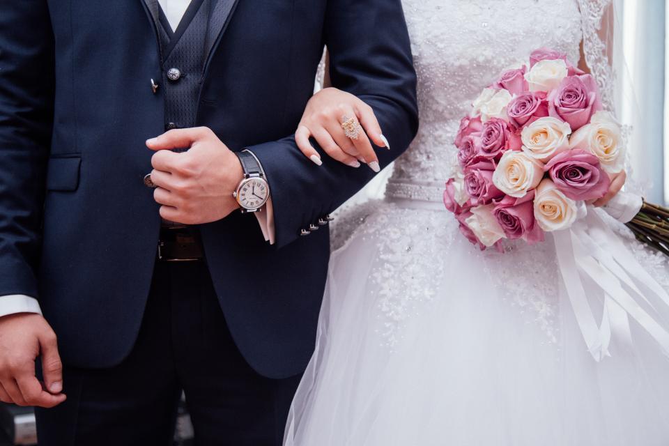 people, couple, man, guy, woman, female, girl, male, bride, groom, wedding, gown, dress, suit, watch, ring, flower, bouquet, marriage, love