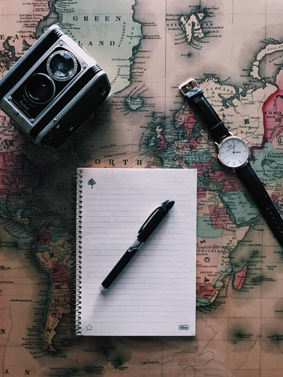 global map geography travel notebook write pen watch camera photography