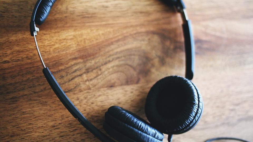 headphones audio technology wood desk
