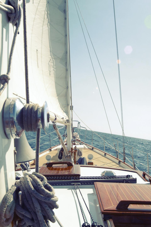 sailboat sailing deck bow rope water ocean sea waves sunshine