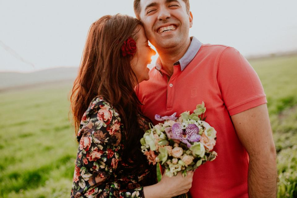nature grass flowers people man woman couple love romance bouquet smiles happy joy