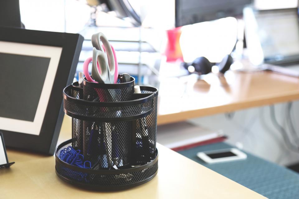 desk office supplies stationary business scissors paper clips pens pencils
