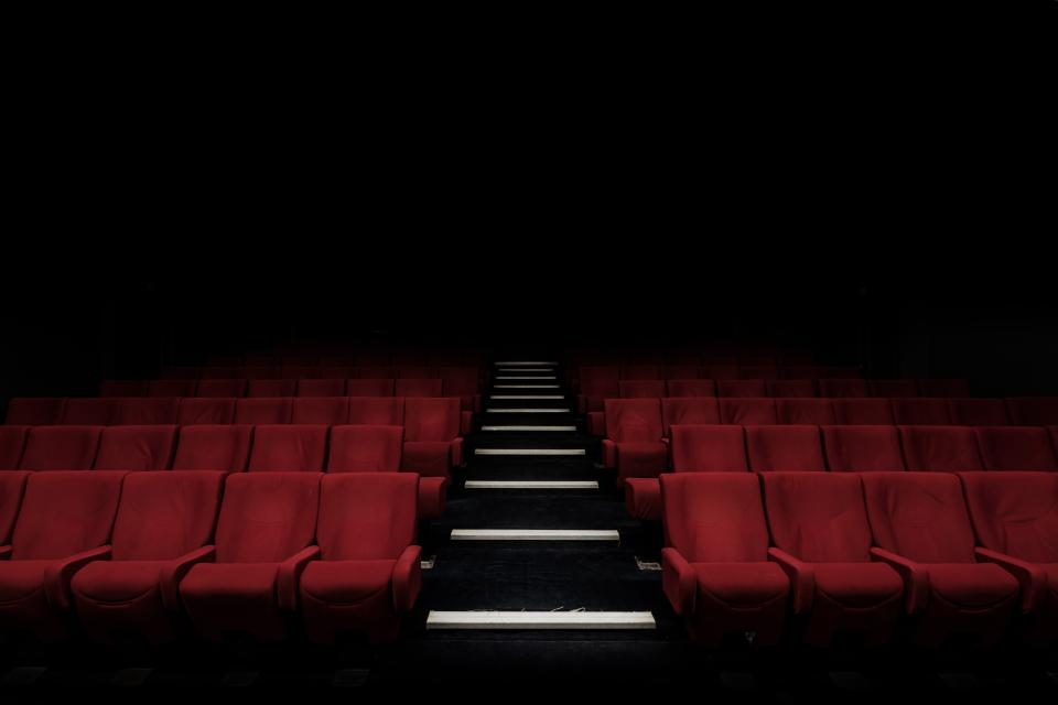auditorium stadium bench chairs inside seats theater dark