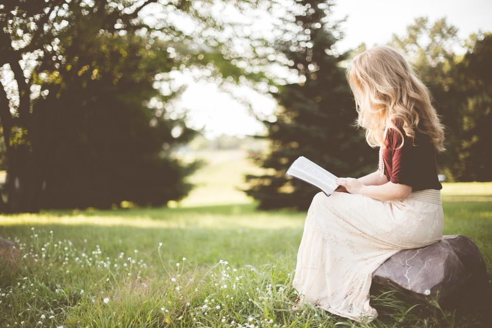 people, girl, alone, sitting, rock, reading, book, bible, nature, green,  trees, grass, bokeh | Stock Images Page | Everypixel