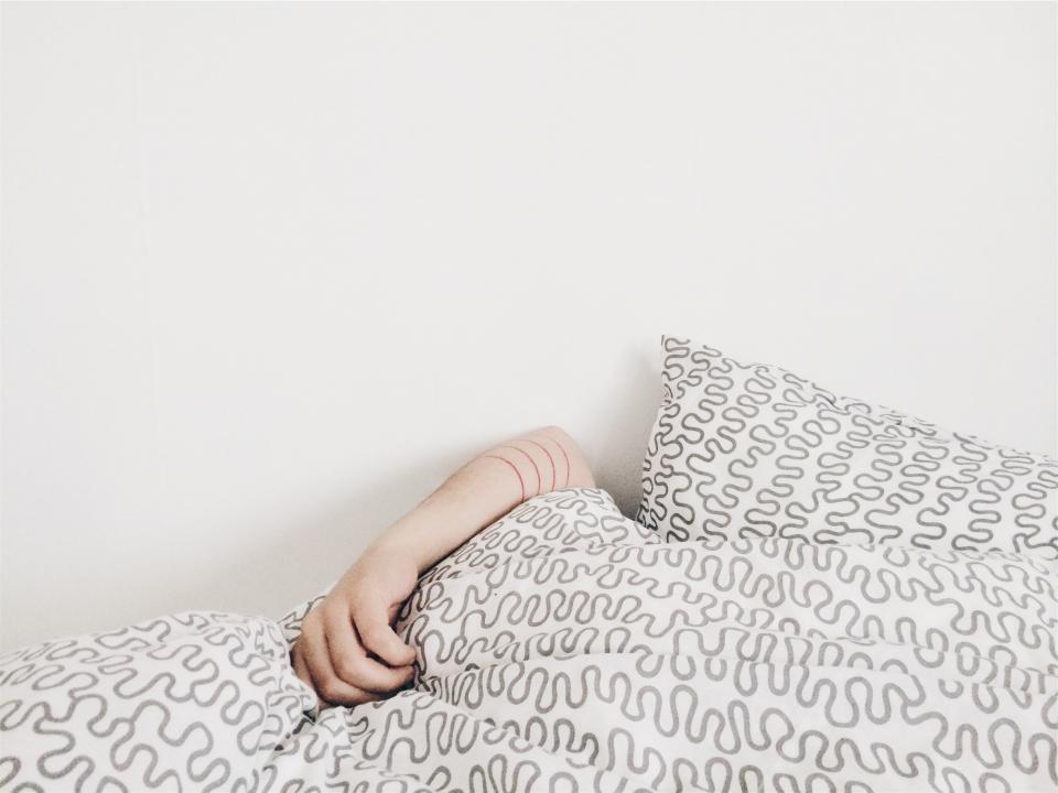 sleeping bed covers pillows arm hand